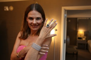 Suzanne Cryer trying on the Leeza Braun bracelet